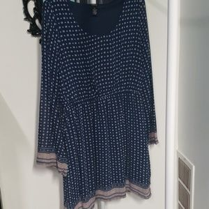 Navy dress with bell sleeves.